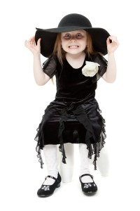 3729605-the-little-girl-hamming-in-a-black-felt-hat